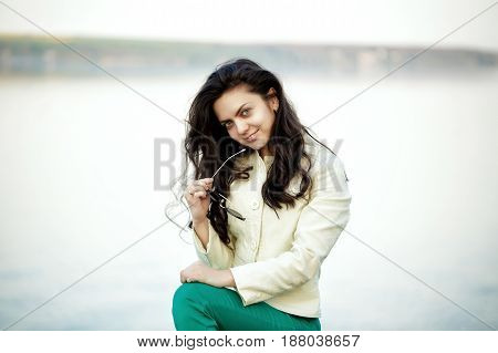 Portrait of young attractive woman brunette smiling outdoors