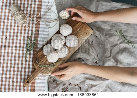 Composition with different spices and mortar on dark wooden background.