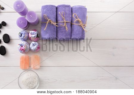 Spa treatment and aromatherapy top view background with copy space on white wood. Aroma salt, soap, herbal balls for indian spa