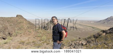 PICACHO, ARIZONA, MAY 21. Picacho Peak State Park on May 21, 2017, near Picacho, Arizona. A Hiker in Picacho Peak State Park near Picacho, Arizona.
