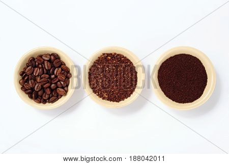 coffee beans fine and coarse ground coffee isolated