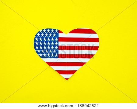 American flag in the shape of a heart on bright yellow background USA independence day