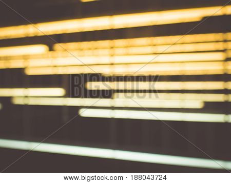 Abstract image, Color blur de focused of neon lights line background in the darkness, Soft focus