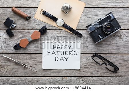 Happy Fathers Day background, flat lay with male presents, watch and other man things on rustic wood