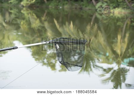 Equipment basket to fish to fall in Natural background