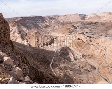 The Roman siege ramp that the tenth legion used to breach the wall and enter the Masada fortress in 74 CE against the barren hills of the Judean desert.