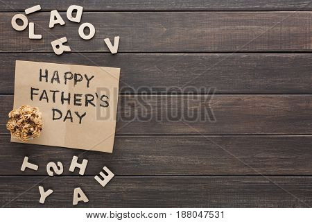 Happy Fathers Day card mockup with copy space, cupcake on rustic wood background