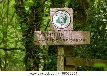 INGLESTONE UK - MAY 19 2017 Wetmoor Nature Reserve sign and Gloucestershire Wildlife Trust logo. Sign at entrance to Gloucestershire Wildlife Trust's reserve with corporate logo including barn owl