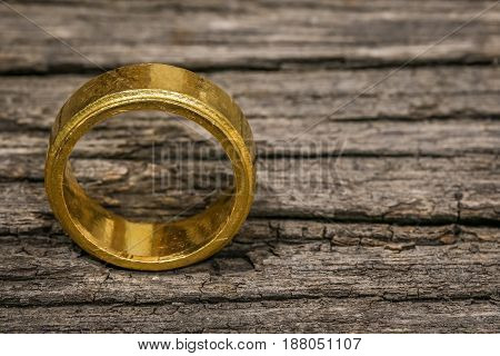 One Single Simple Golden Ring On The Wooden Table With Copy Space