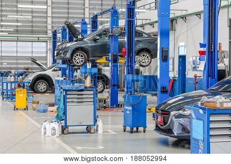 Bangkok Thailand, December 10, 2016: Car In The Lifting Equipment In The Garage Being Repair And Fix