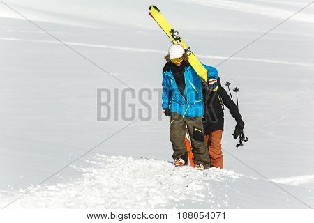 Skier Skiing On Fresh White Snow With Ski Slope On Sunny Winter Day