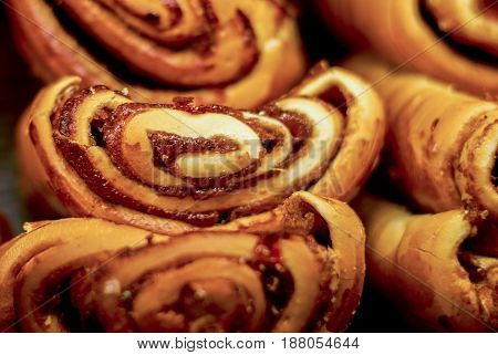 Sweet buns. Freshly baked buns on a dark background