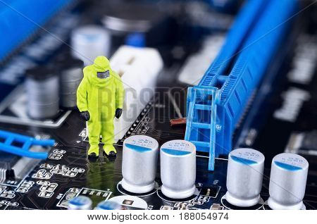A single toy technician is repairing or cleaning a motherboard.