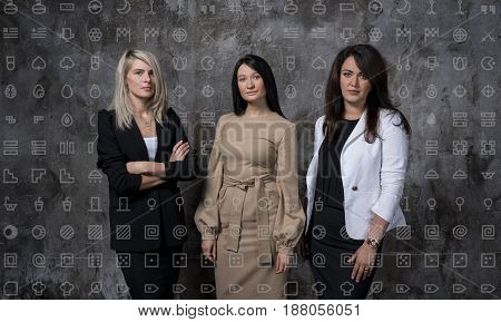 Three business women in an office. Style Graphs