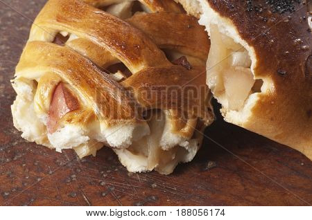 Two apple pies on a timber board close up