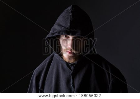 Bearded man wearing like hooligan on black background