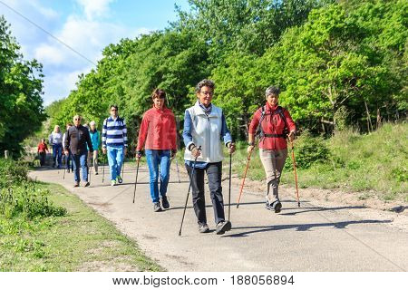 Kijkduin beach the Netherlands - May 20 2017: nordic walkers in a park