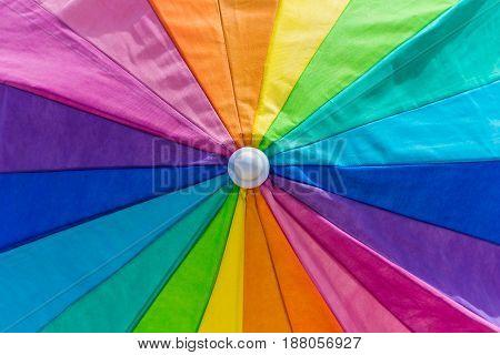 closeup of a vibrant rainblow colour umbrella