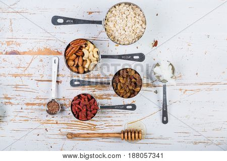 Granola and ingredients on rustic background, copy space