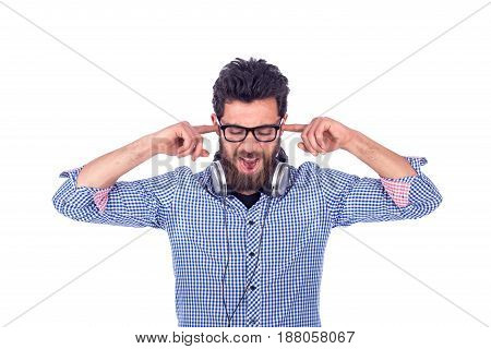 handsome beard yong man closing his ears guy wearing glasses and blue shirt isolated on white background