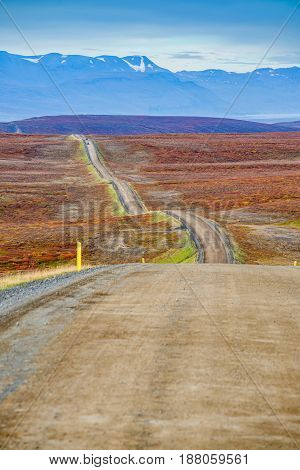 Endless road going trough hills in Iceland