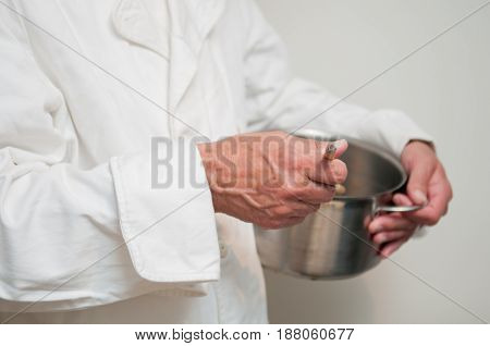 Chef Preparing Food Cooking With A Pan