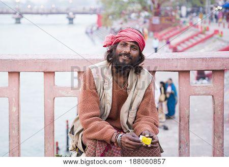 HARIDWAR, INDIA - MARCH 23, 2014: Sadhu portrait on the bridge of Ganga river