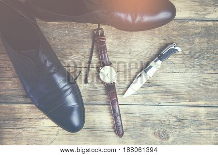 stylish men's watchesknife and black dress shoes