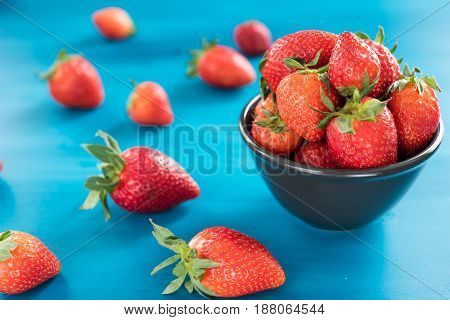 Ripe red strawberries on wooden table, Fresh strawberry, Strawberries in white bowl.