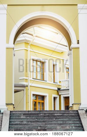 Archway entrance in the yard building staircase