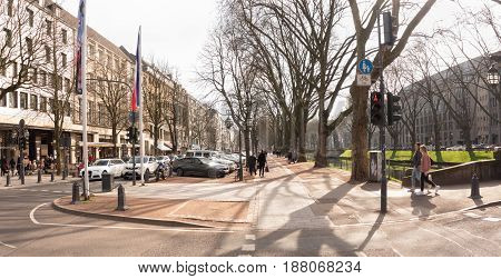 DUESSELDORF, GERMANY - MARCH 13, 2017: Unidetified shoppers stroll along the famous Koenigsallee and ejoy the warm sun.