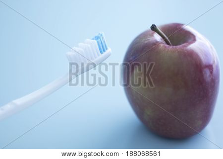 Dental Toothbrush And Apple