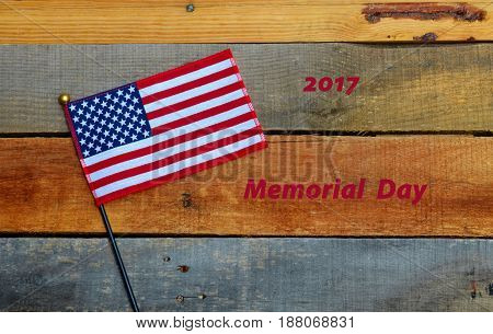 2017 Memorial Day text displayed with USA American flag on pallet wood backdrop.