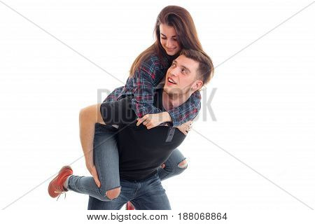Guy wears his girl on hands isolated on white background