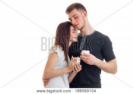 cute loving couple hugs and drinks coffee isolated on white background