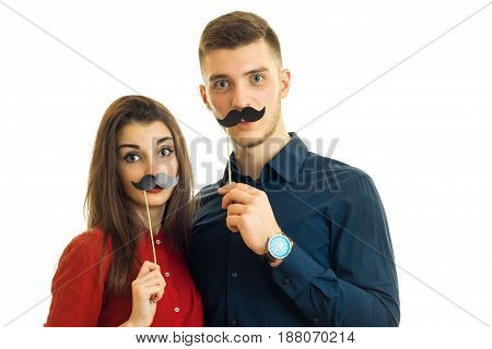 fun loving couple with a paper mustache isolated on white background