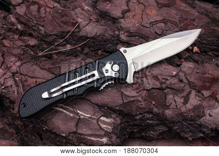 Pocket Knife In Unfolded Form With A Clip. A Sharp Knife.