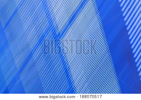abstract graphic background in blue tones with a pattern of parallel lines horizontally