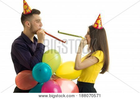 cheerful couple having fun at a birthday party isolated on white background