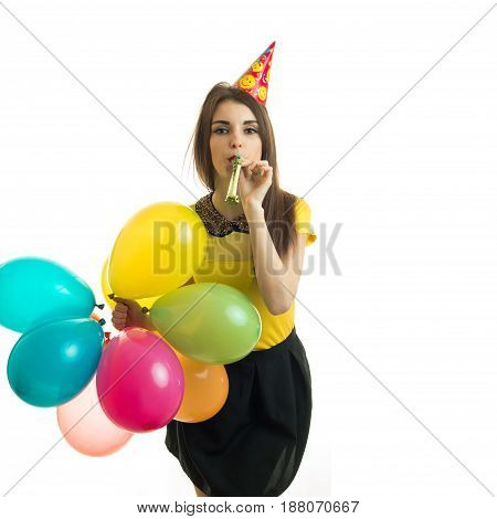 elegant beautiful girl having fun at a birthday party isolated on white background