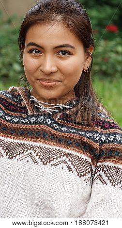 A Peruvian Female Wearing a Knit Sweater