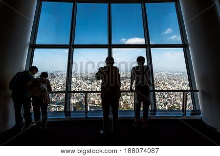 Tokyo, Japan - April 19, 2017: people watching Tokyo skyline in Sumida District from Tembo Deck observation deck. The Tokyo Skytree is a television broadcasting tower and landmark of Tokyo.