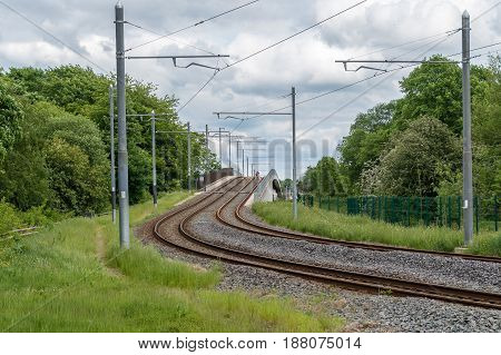 Tram or train tracks with overhead electric wires