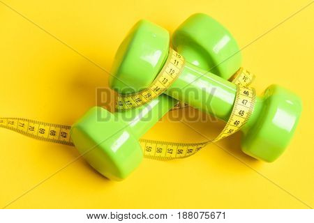 Ideal Size. Dumbbells In Green Color With Measuring Tape