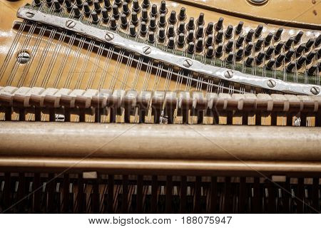 Closeup detailed view of old vintage piano strings