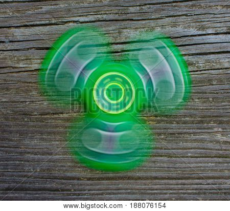 Fidget spinner in motion.  Current modern fun and relaxing for children and adults.  Spinning gadget, motion and energy.