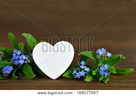 Fathers Day card with heart and blue flowers