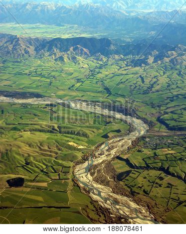 Aerial View of the Waiau River North Canterbury New Zealand. In the foreground is Waiau township and in the background is Hanmer and farms.