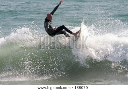 Surfer Carving A Wave