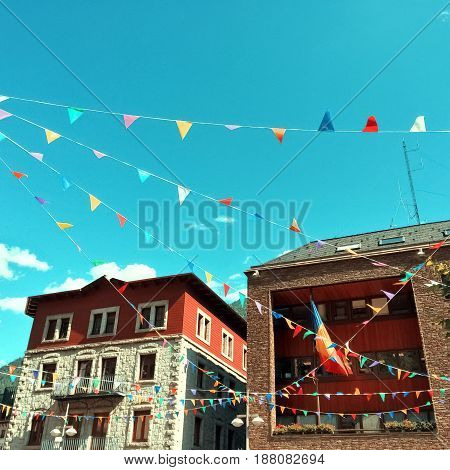 Street of Andorra La Vella decorated with colorful pennants. Capital of Andorra.